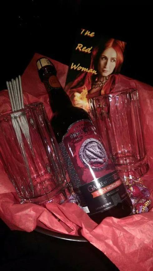 The Red Woman: Ommegang Brewery Valar Morgulis beer, 2 glass mugs, sparklers, and Fireball candies.